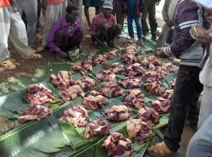 Sharing meat at the market in Laska