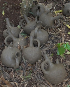 Clay coffee-pots drying outside