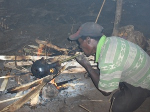 Baskeet potter burning a coffee-pot